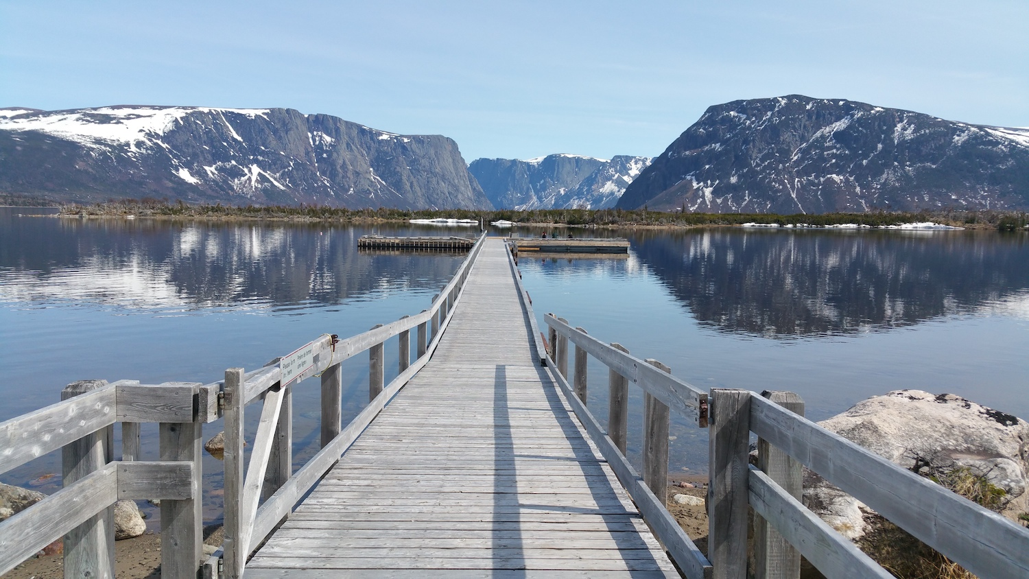 """""""Boardwalk into Western Brook Pond with mountains in Gros Morne National Park, Newfoundland"""" By Julie A Lynch via Shutterstock"""